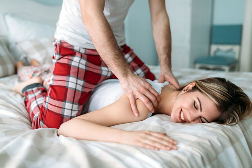 Photo of man giving her lady a massage