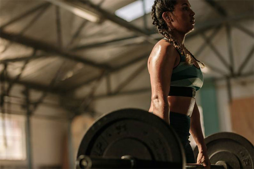 photo of woman dead lifting