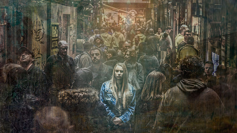 photo of anxious woman in a crowd