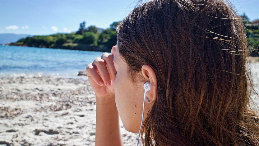 photo of woman with earphones